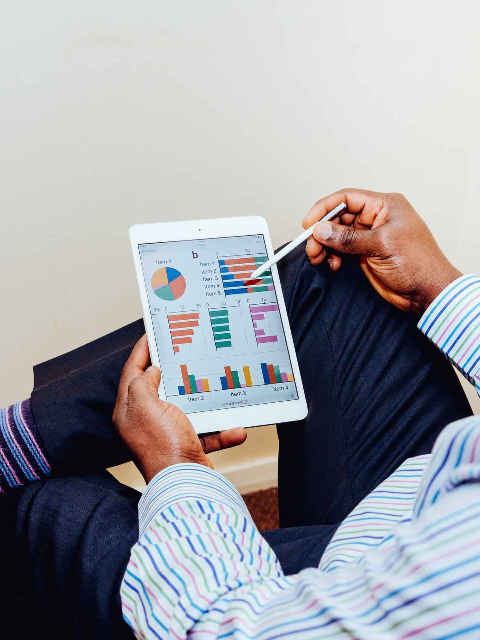 Man on iPad showing charts online business coaching 1 on 1